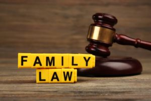 A gavel and blocks with letters regarding child-custody and family-law concept