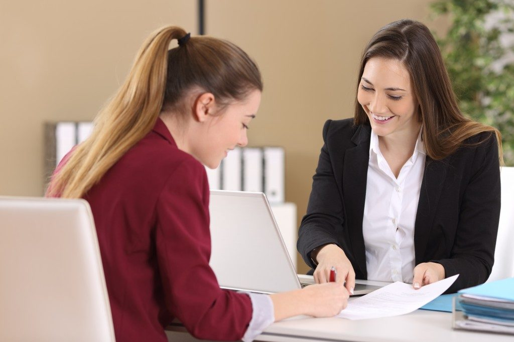 Interviewer reviewing the contract with the candidate
