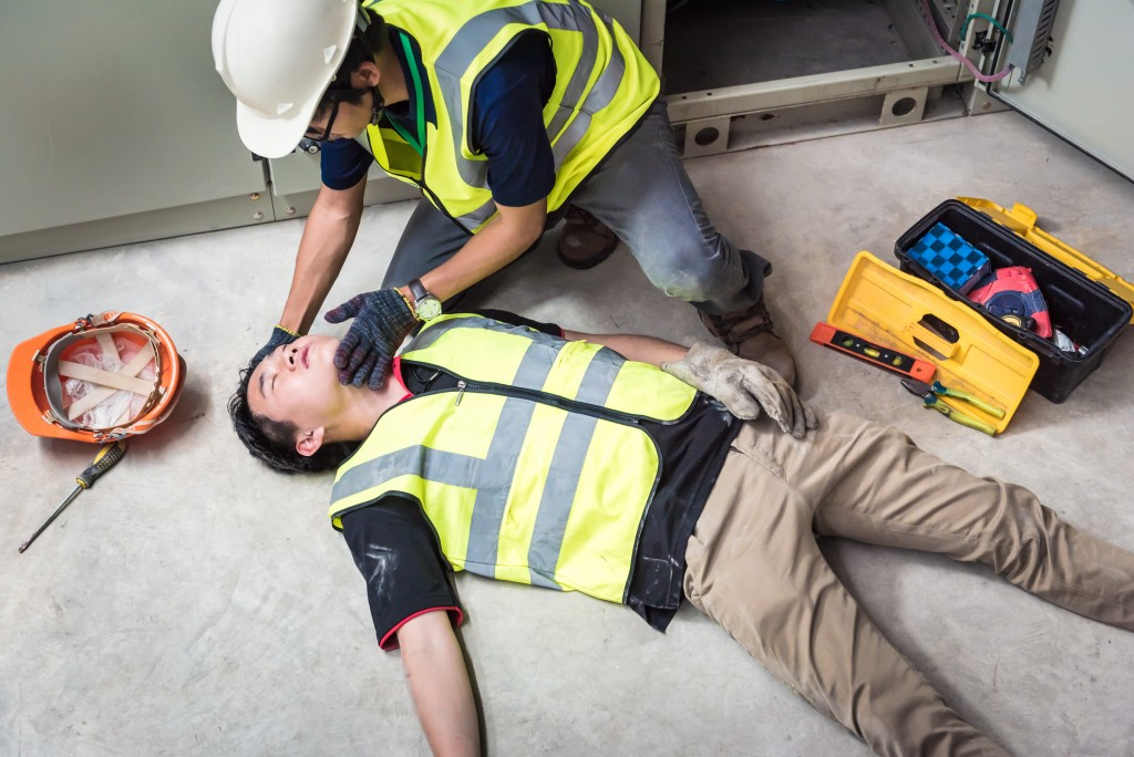 Injured worker lying on the floor