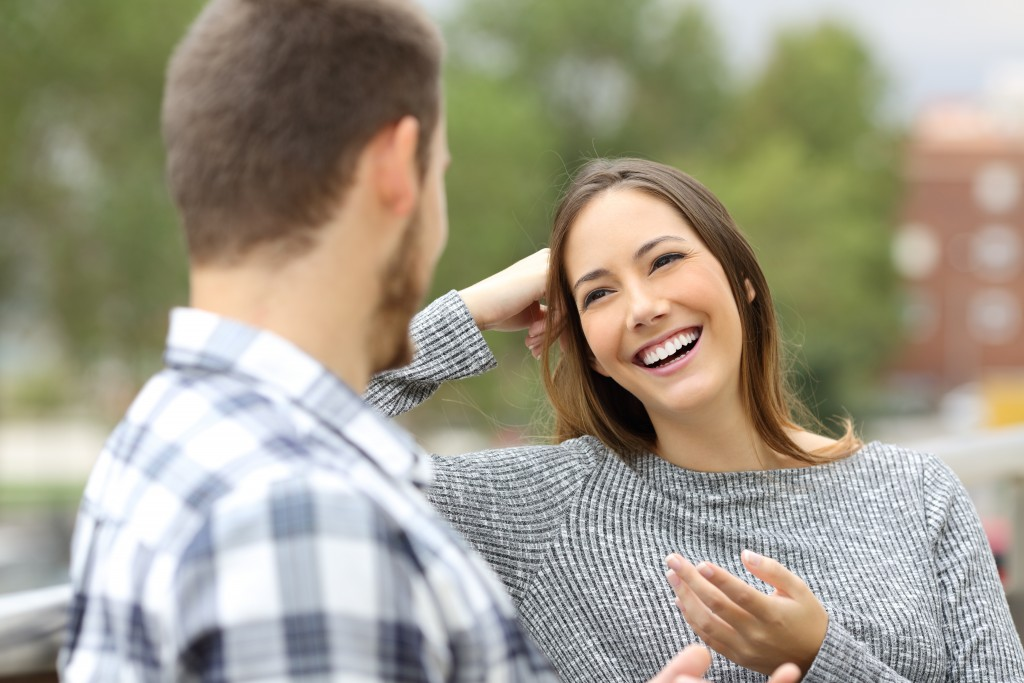 woman happily talking with a man