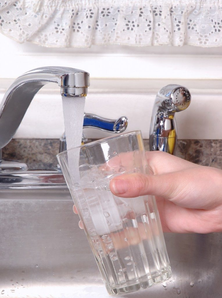 getting water from faucet