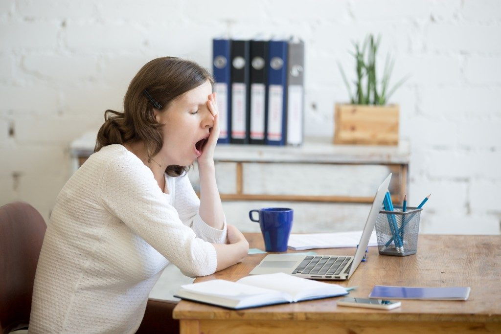 woman yawning while working