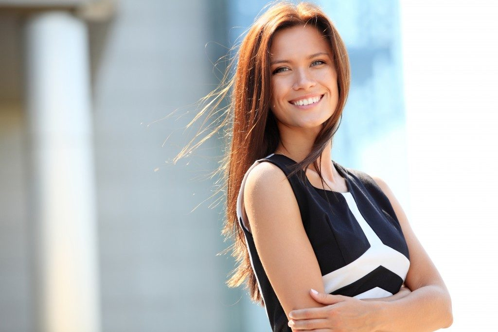 business woman posing and smiling