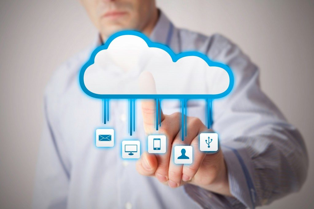 man interacting with cloud service applications