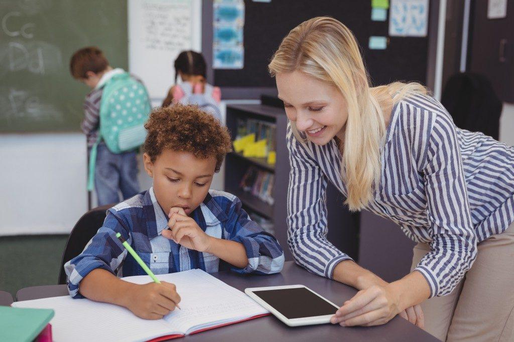 teacher guiding her student