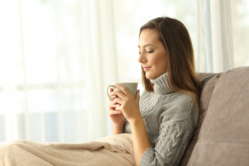 Woman relaxing with cup in hand