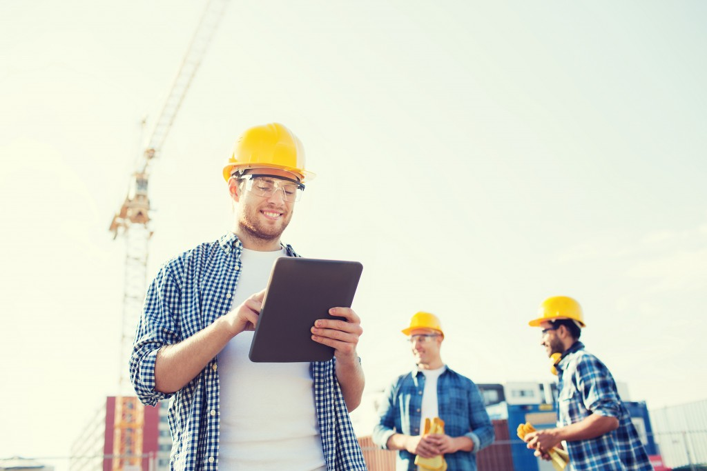 worker looking at graphic tablet