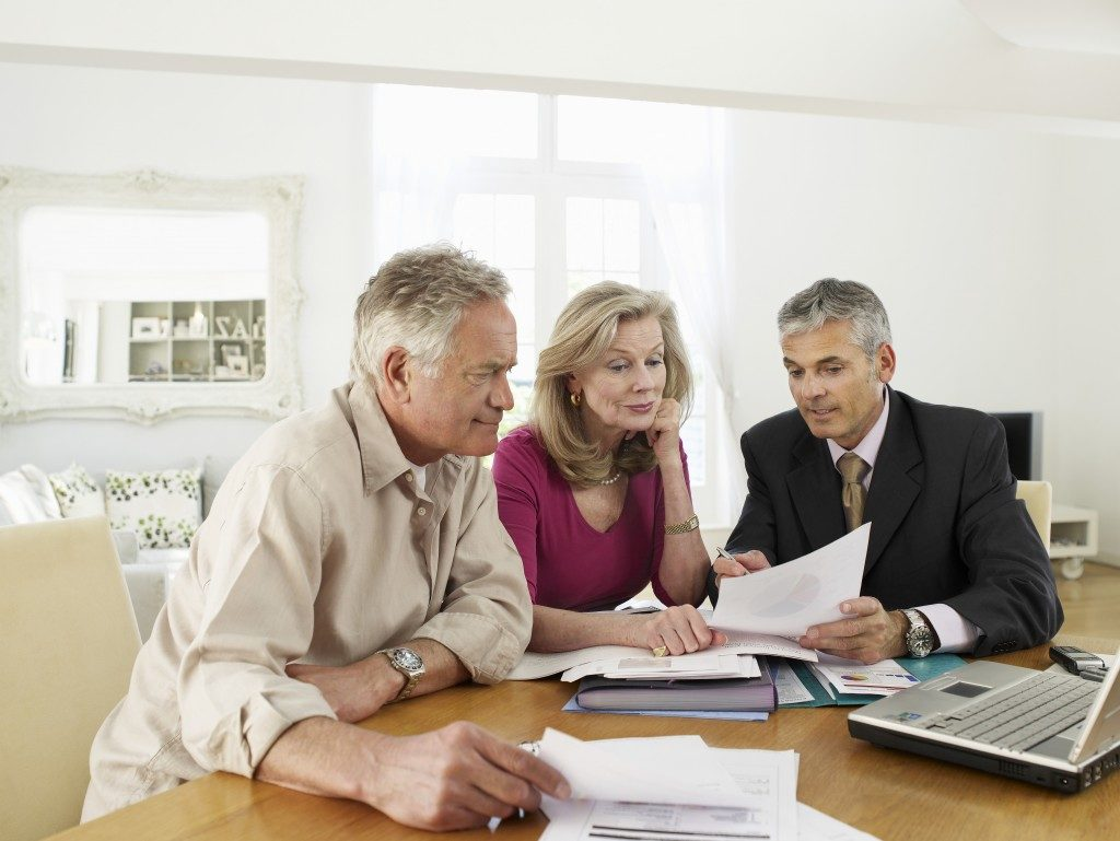 senior couple in consultation with financial planner