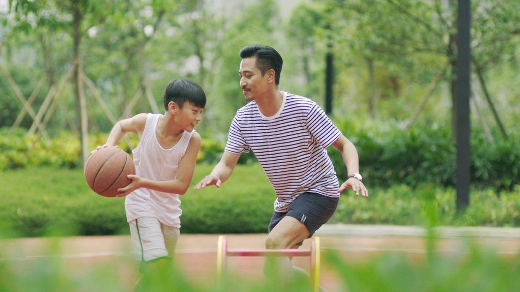 Dad and son playing basketball