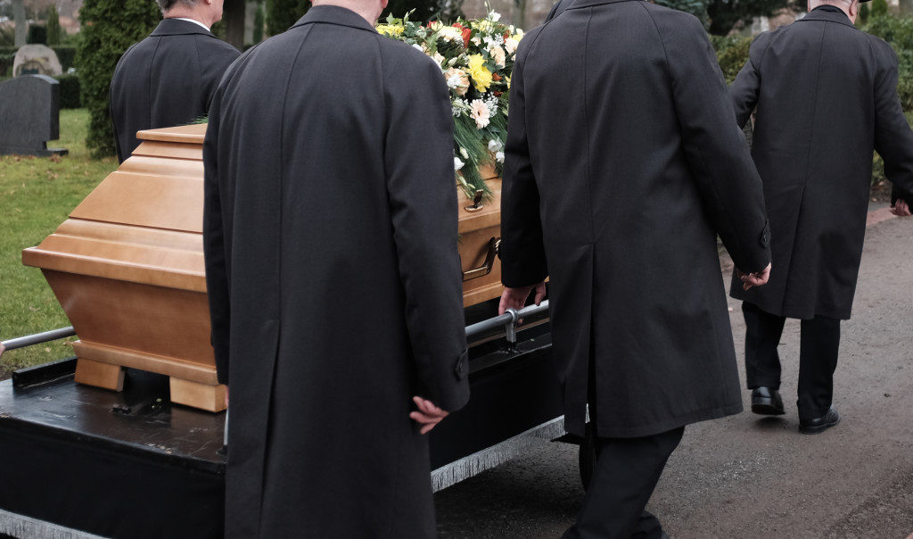 people carrying a casket