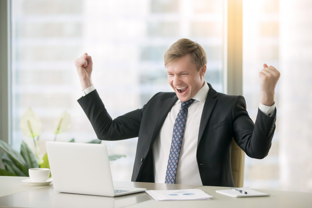 man feeling happy at work