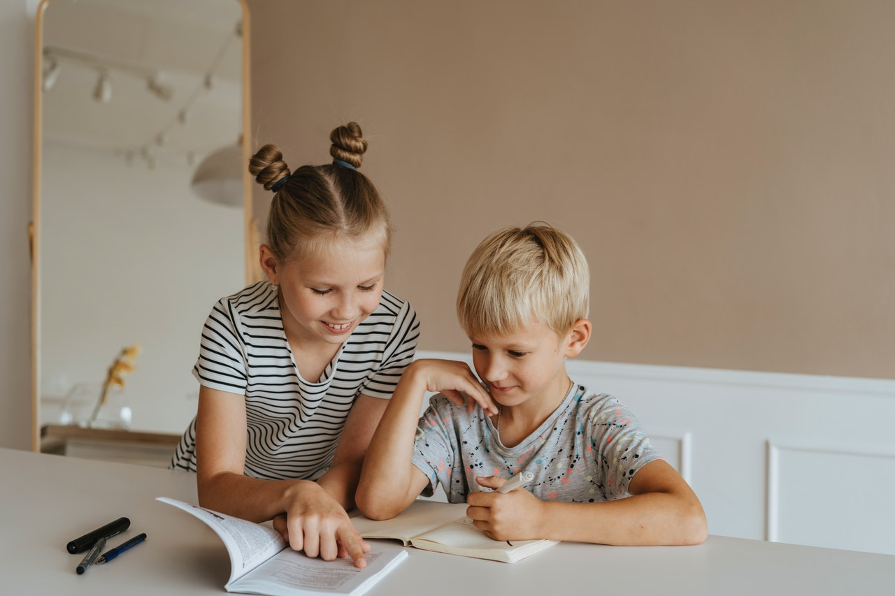two kids studying